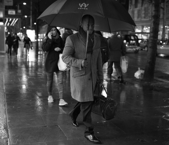 Umbrella & rain, portrait in rain, streetphotography